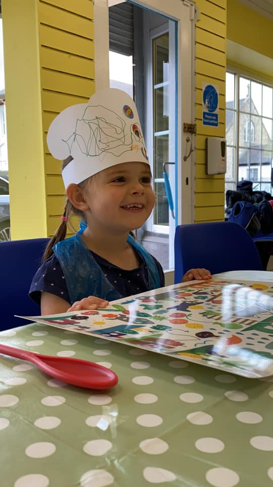 Little girl in chefs hat